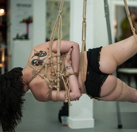 bdsm hanging a lady in a rope