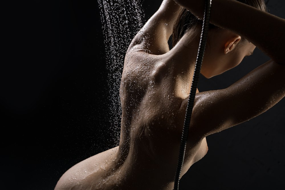 Hot naked woman under the shower