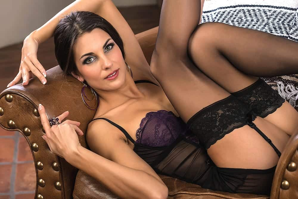 seductive milf wearing sexy black and violet see through corset lingerie