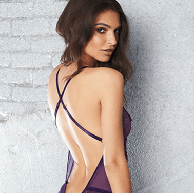hot young lady wearing violet sheer lingerie showing her back