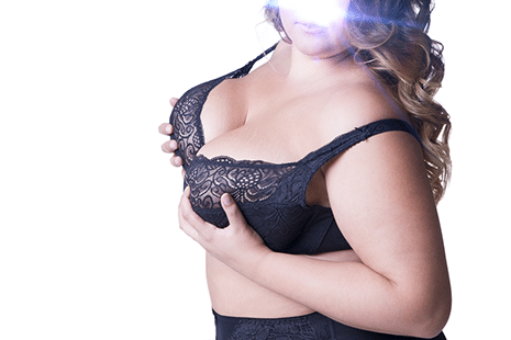 A big-bosomed curly healthy woman in her black pair of lingerie