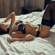 woman wearing black sexy see through lingerie, black lace choker and black stocking