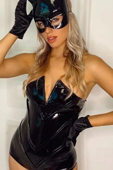 Gorgeous woman in a black strapless Catwoman costume with black mask and gloves