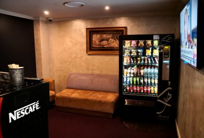 vending machine with snacks and beverages inside cleos reception area