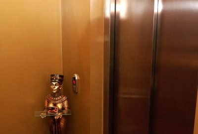 Cleos on nile elevator area door with an egyptian lady statue