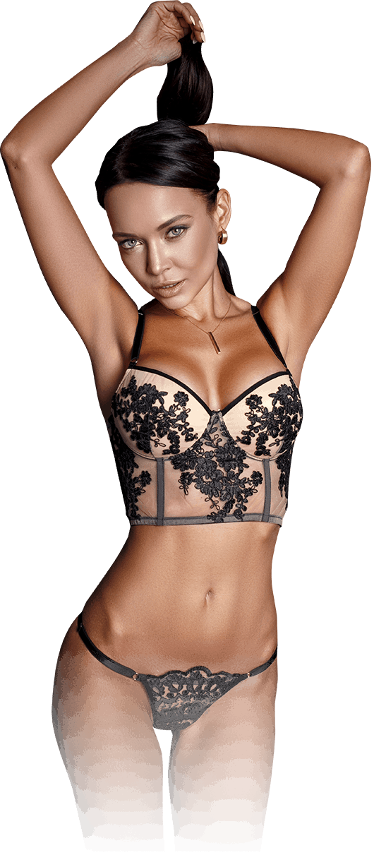 stunning woman wearing nude and black floral embroidered lingerie